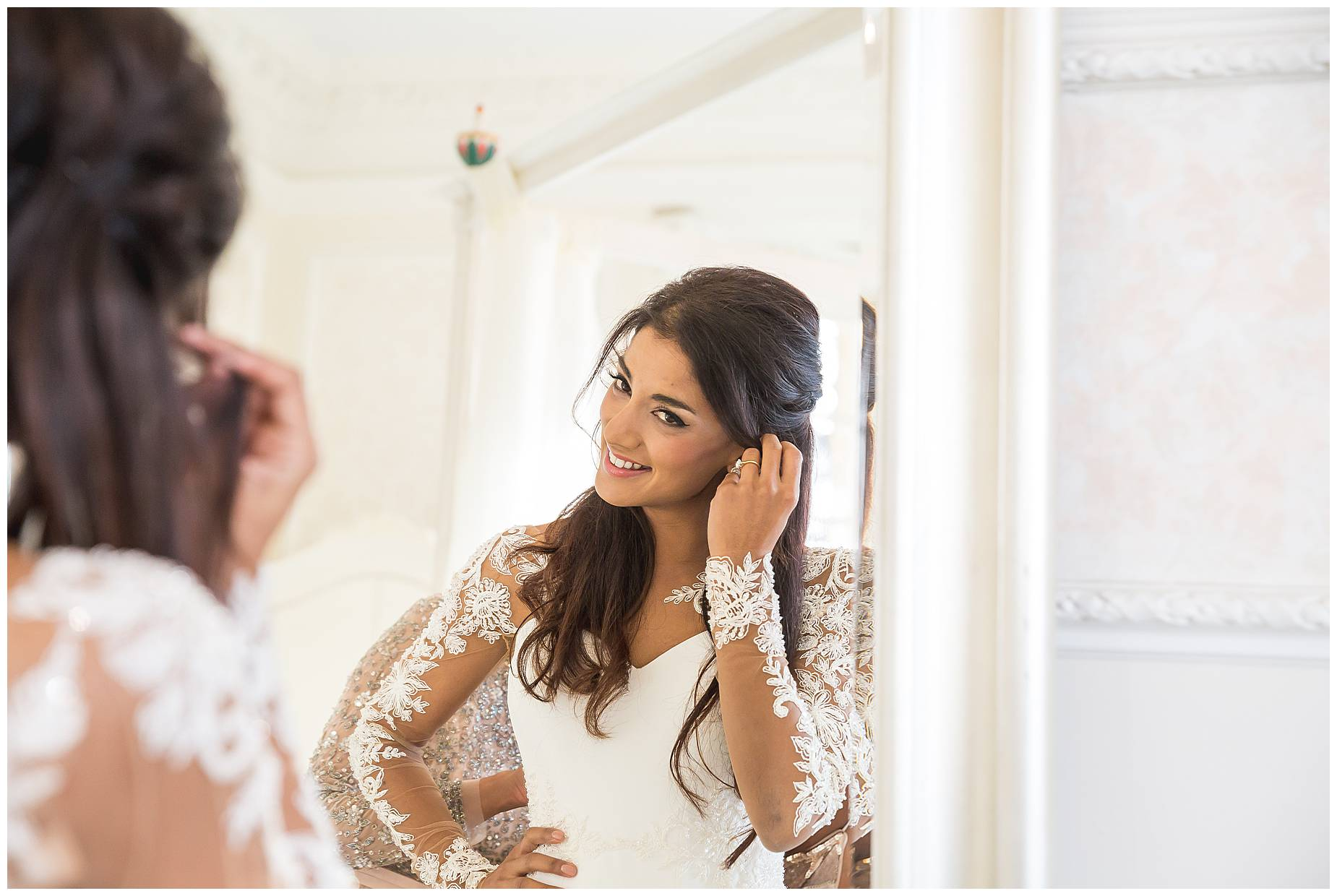bride smiles at the mirror