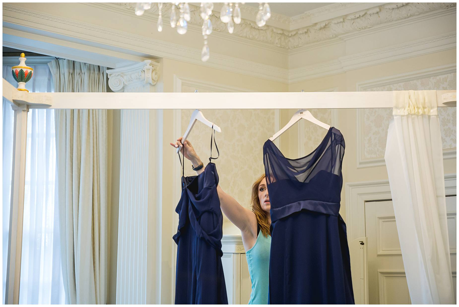 taking down dresses at Hedsor House