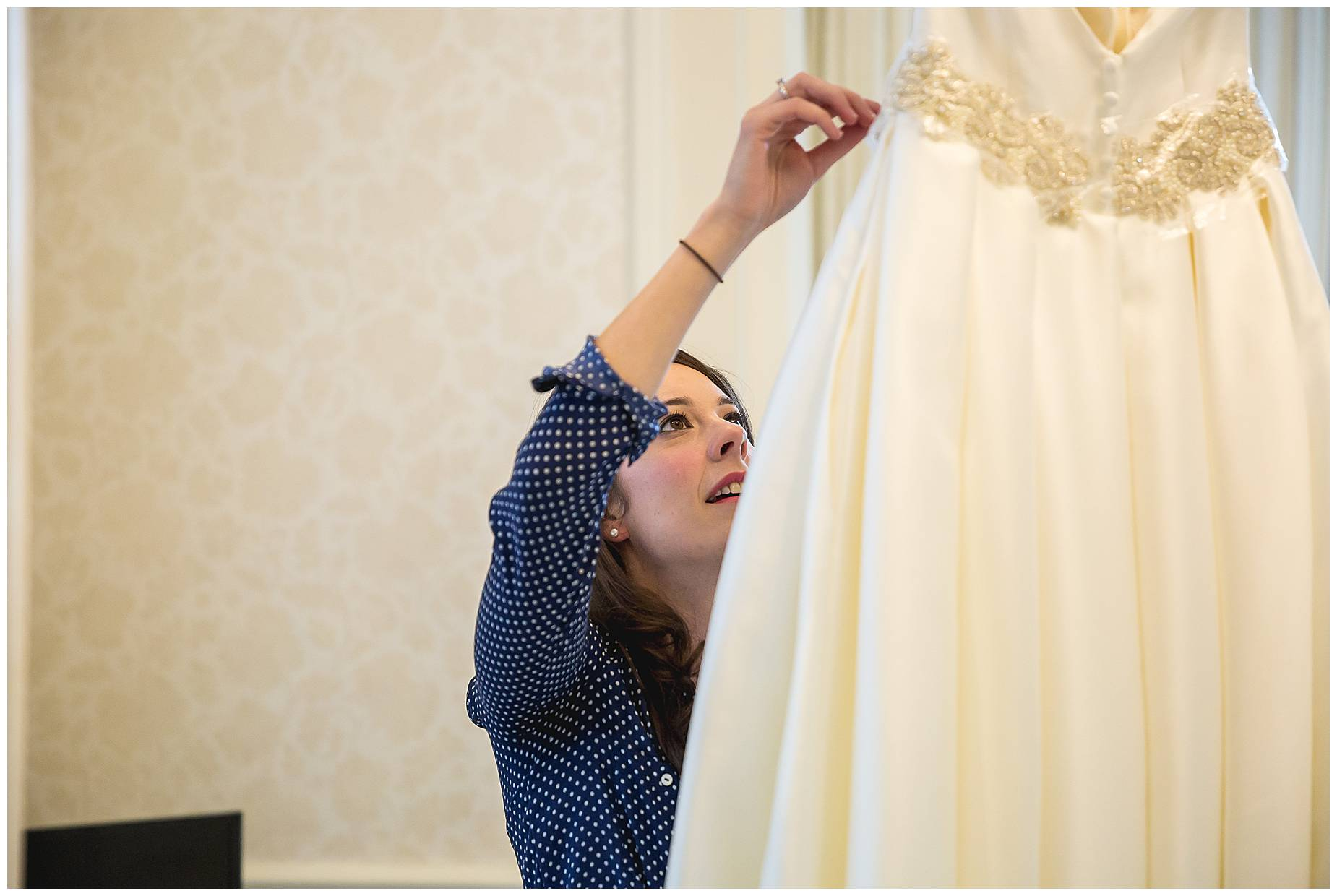 bride getting her dress
