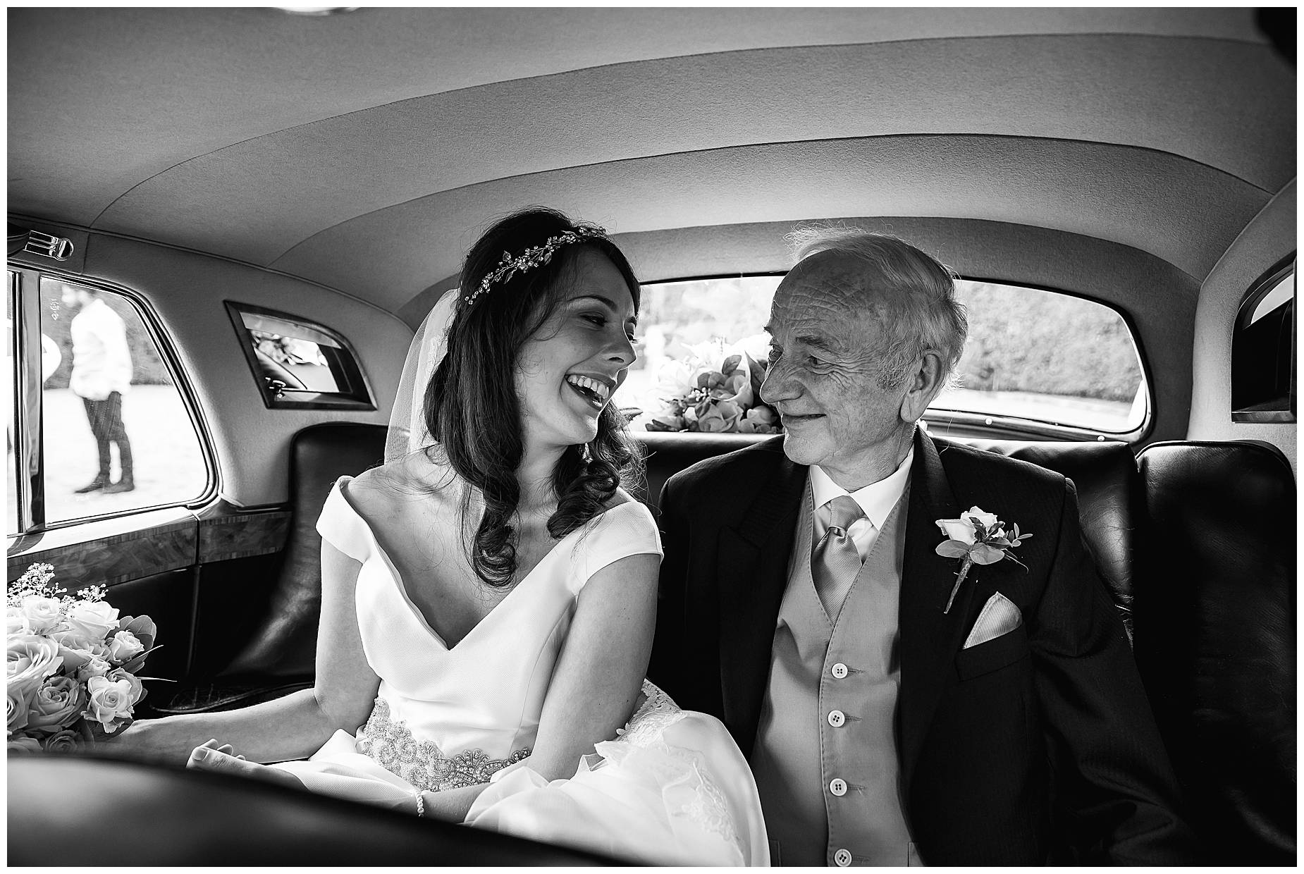 bride and Dad in back of car