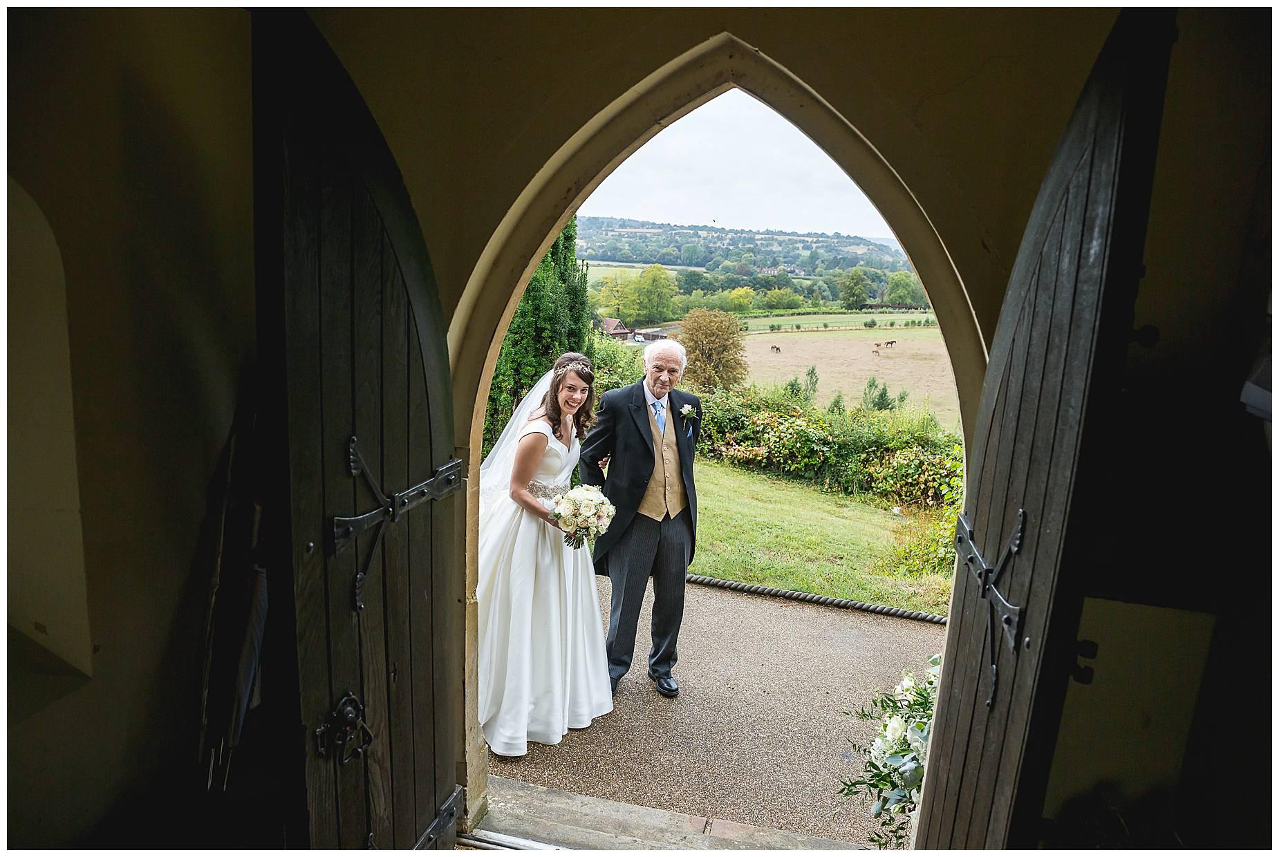bride and dad look through doorway Hedsor