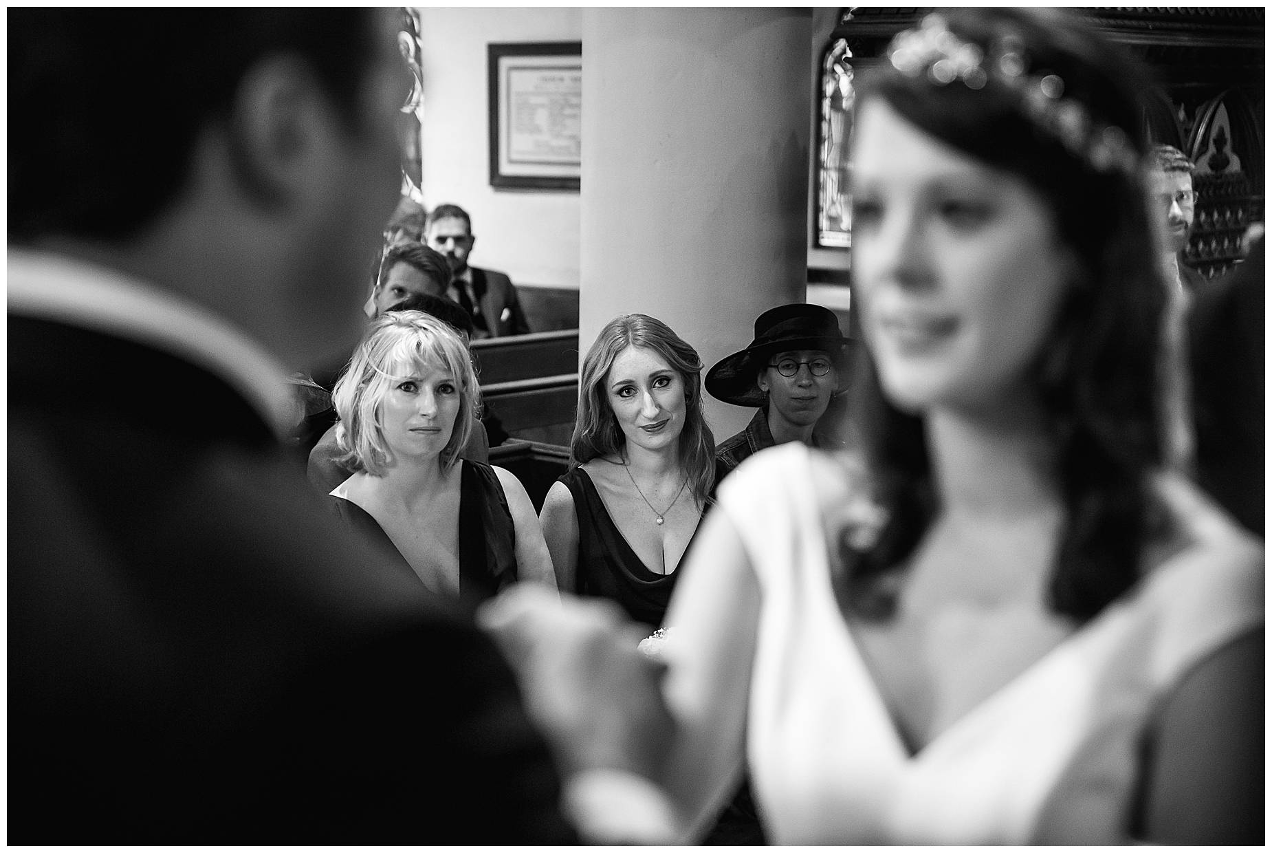 bridesmaids look at bride getting married