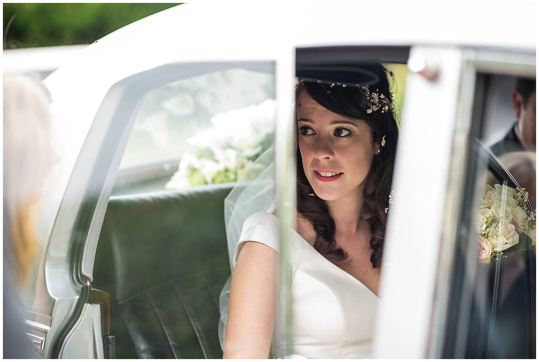 bride looks out of the car