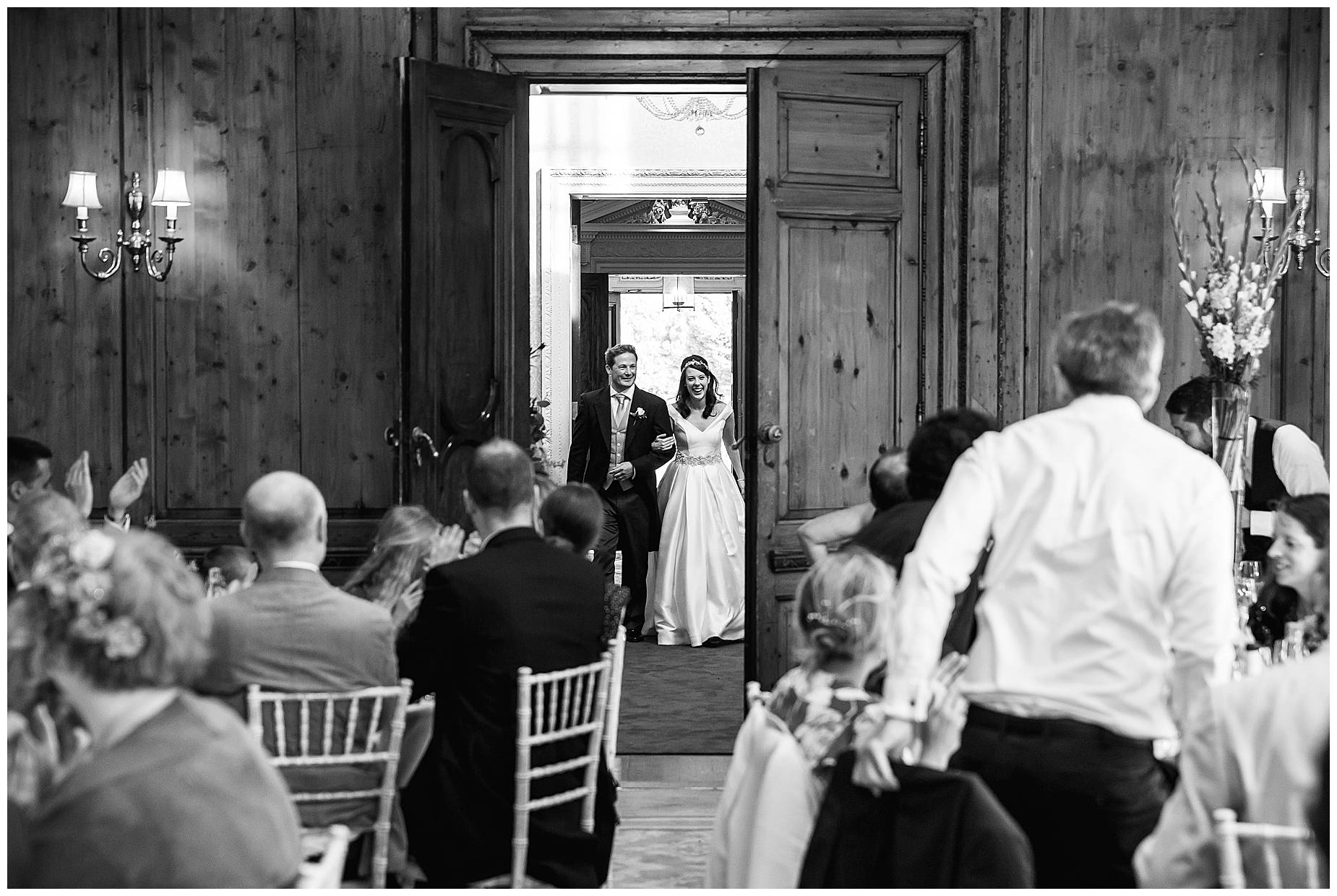 couple enter the dining room at hedsor house