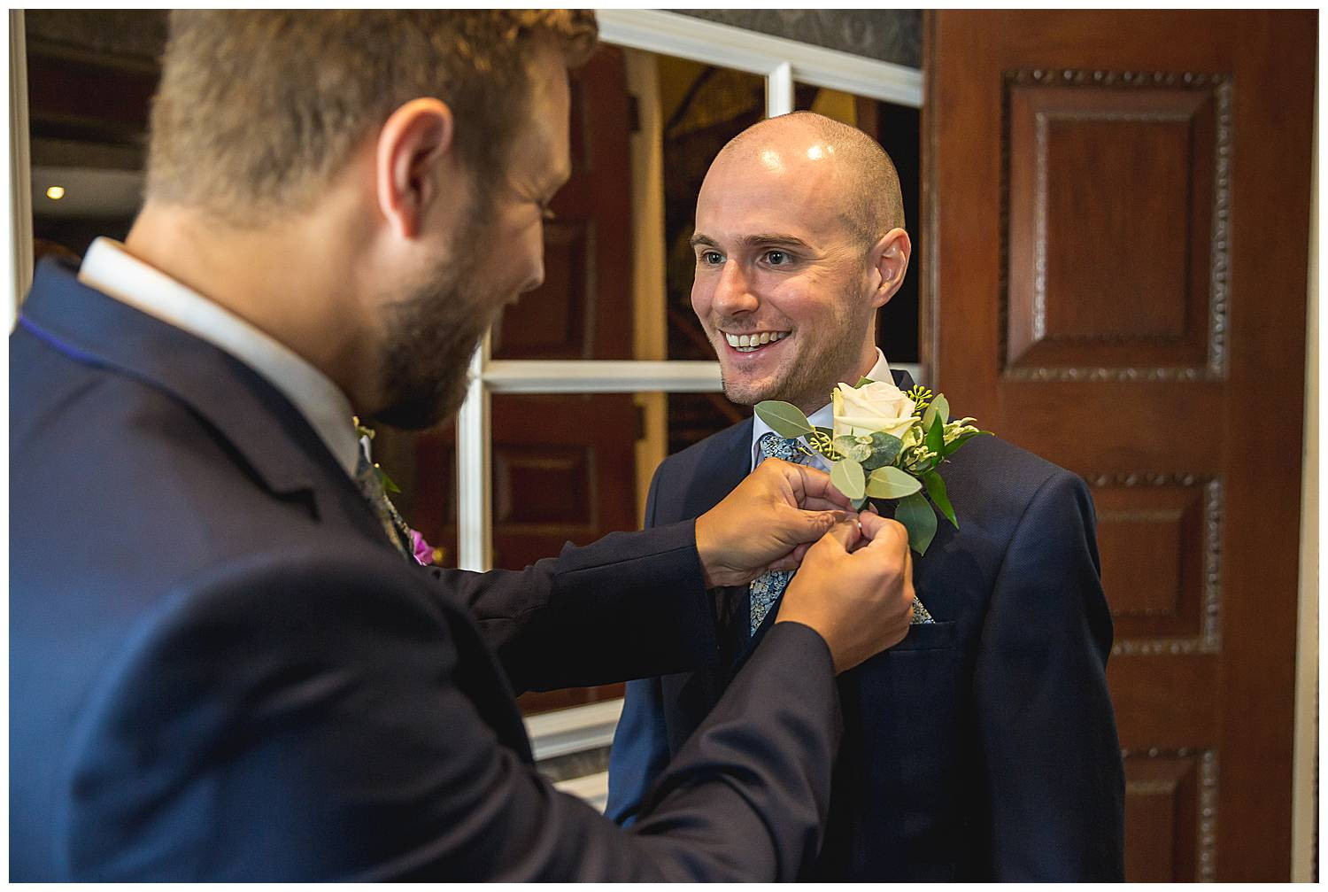 groom has his button hole tied