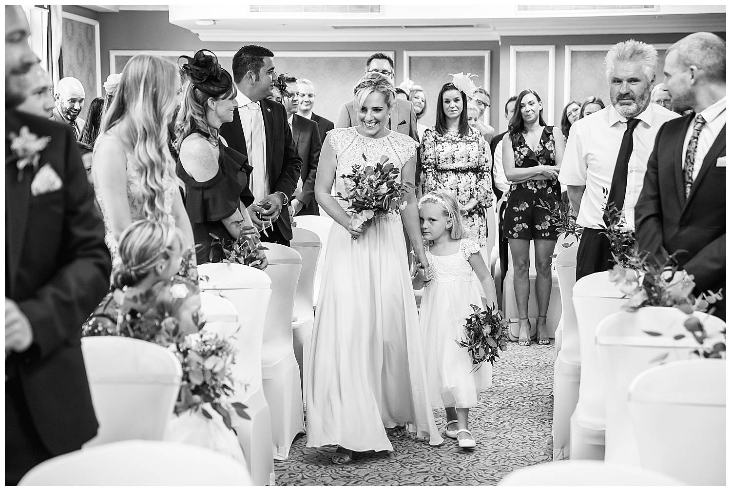 bridesmaids walk down the aisle at Cannizaro House Wedding