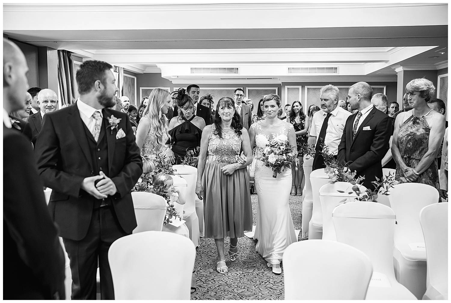 bride walks down the aisle at Cannizaro House Wedding