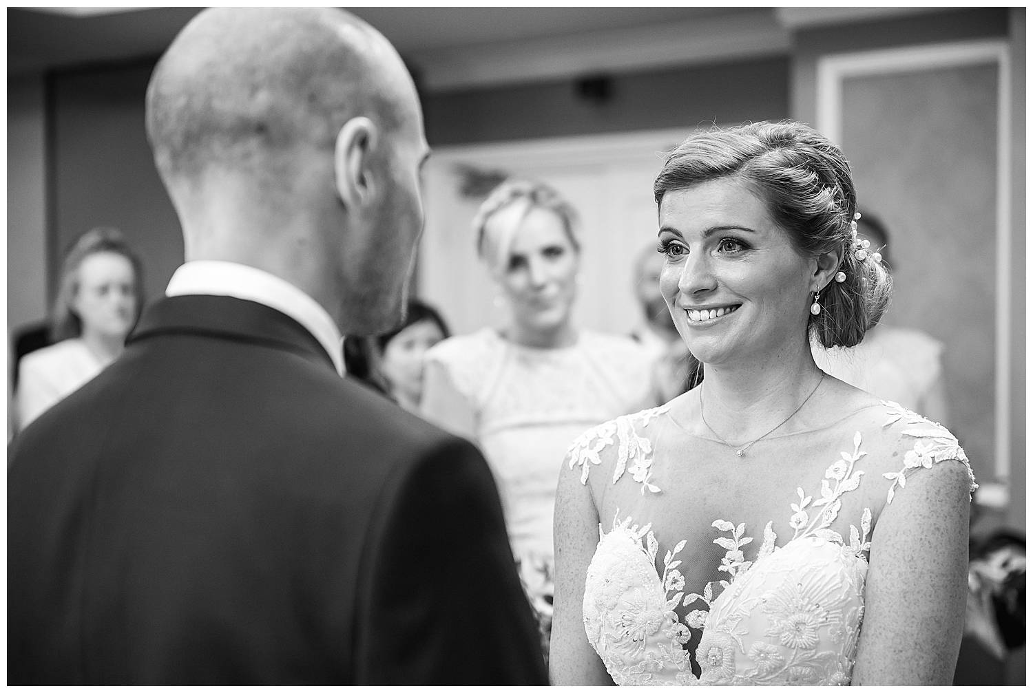 bride smiles in ceremony