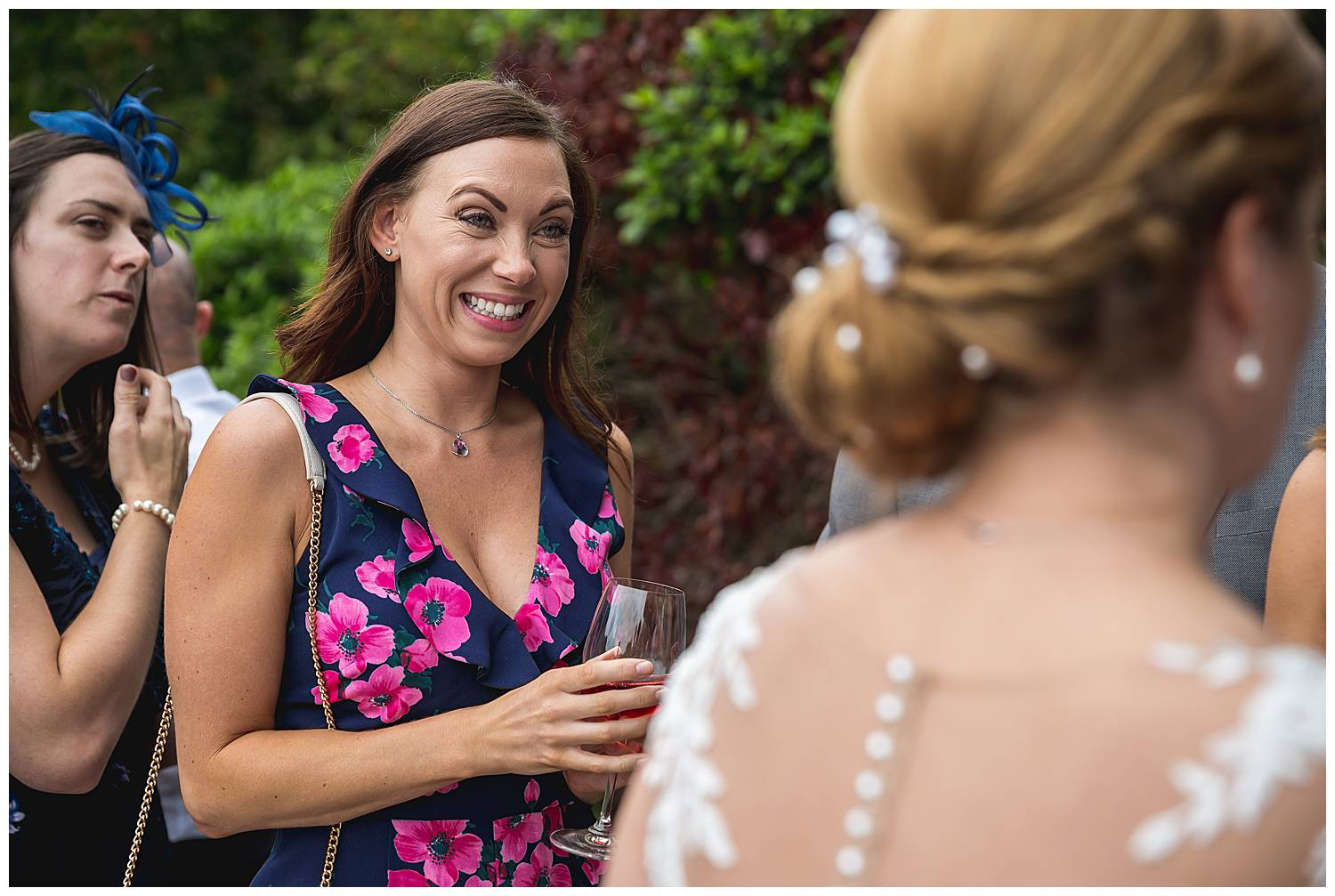 guest smiles at bride