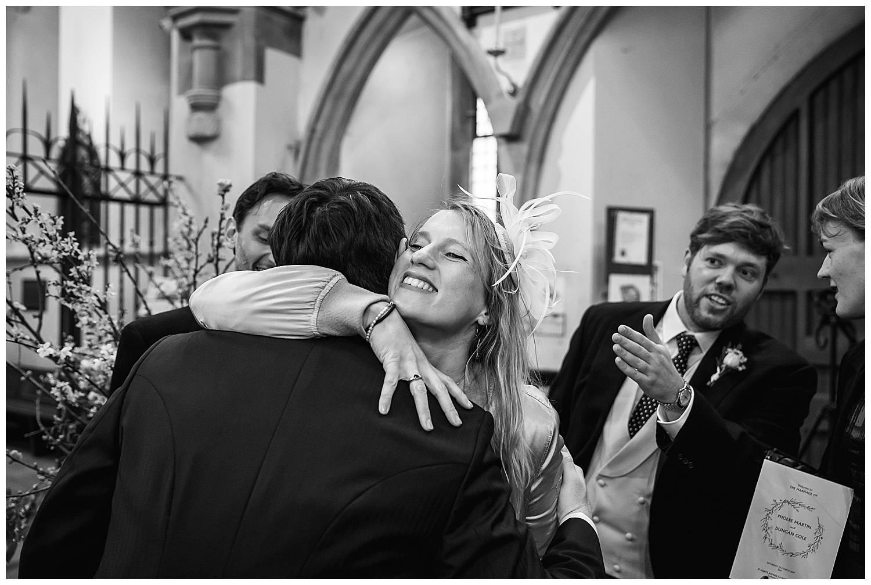 guest hug the groom at Hurlingham club wedding