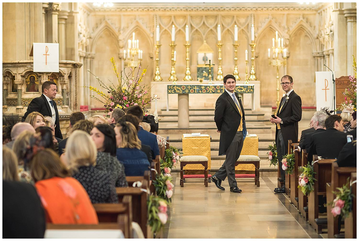 Groom waits for bride in Fulham church