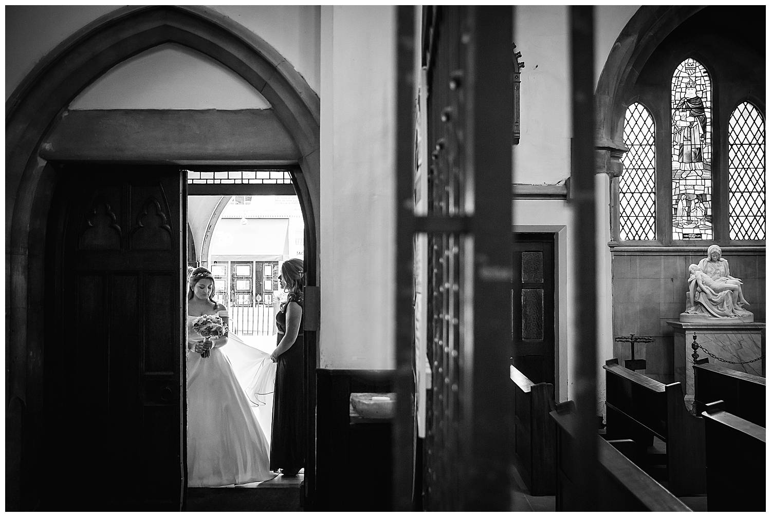 bride waits at the church doorway