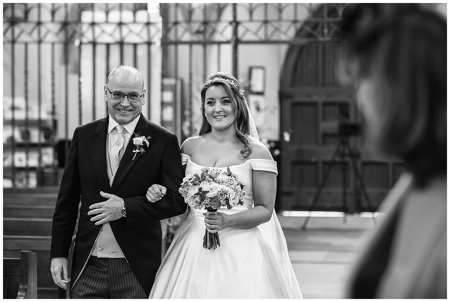 bride walks down the aisle at her London wedding