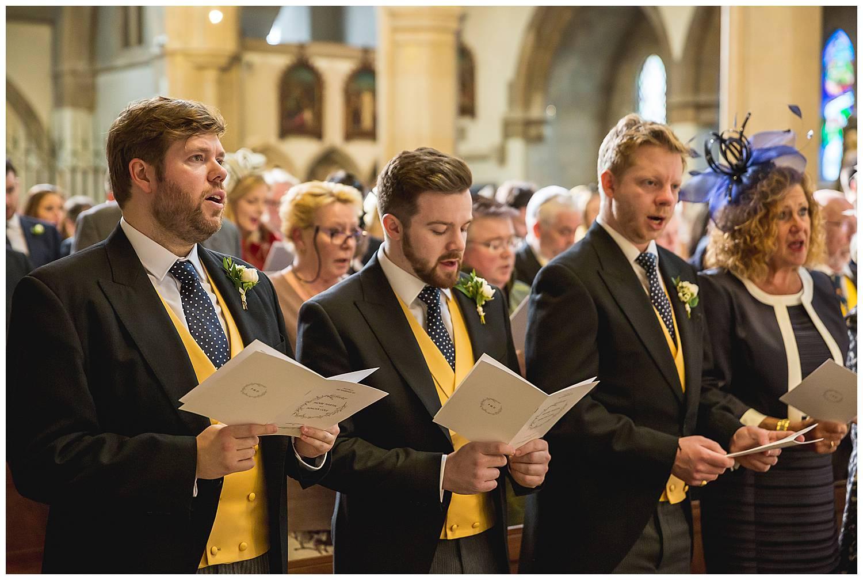ushers sing at London wedding