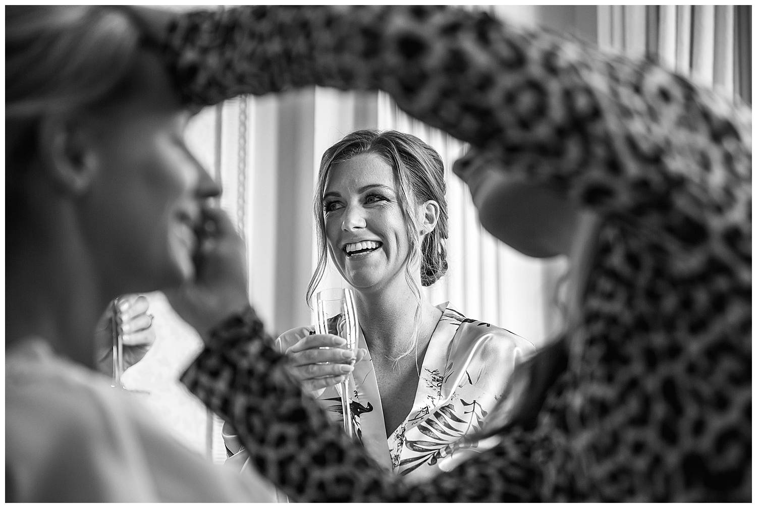 bridesmaid laughing in black and white