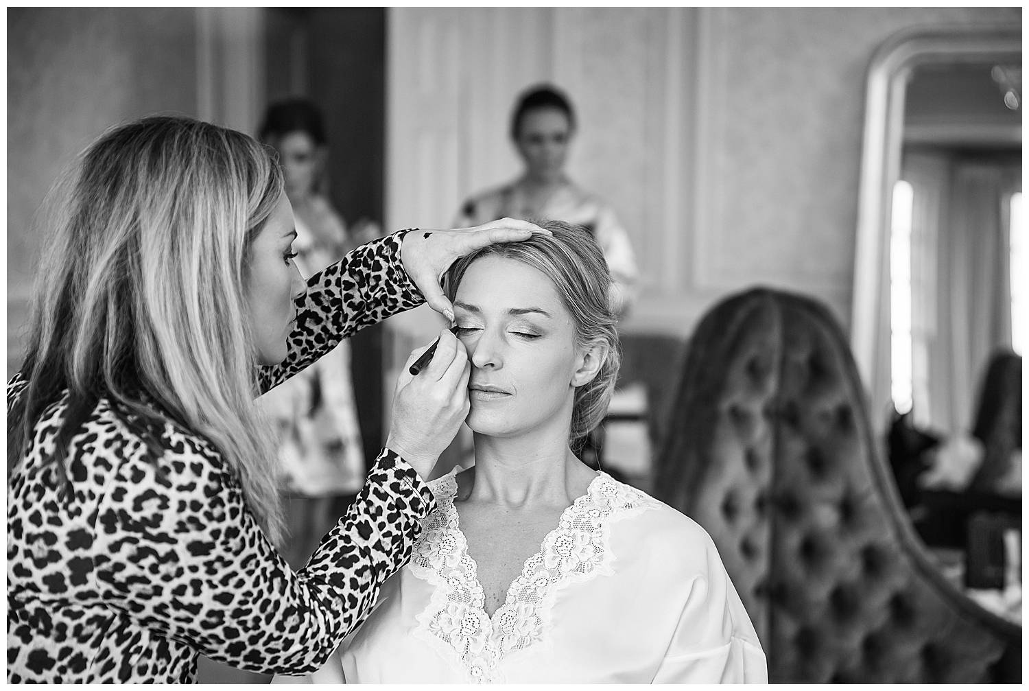 bride having make up applied at Hedsor House