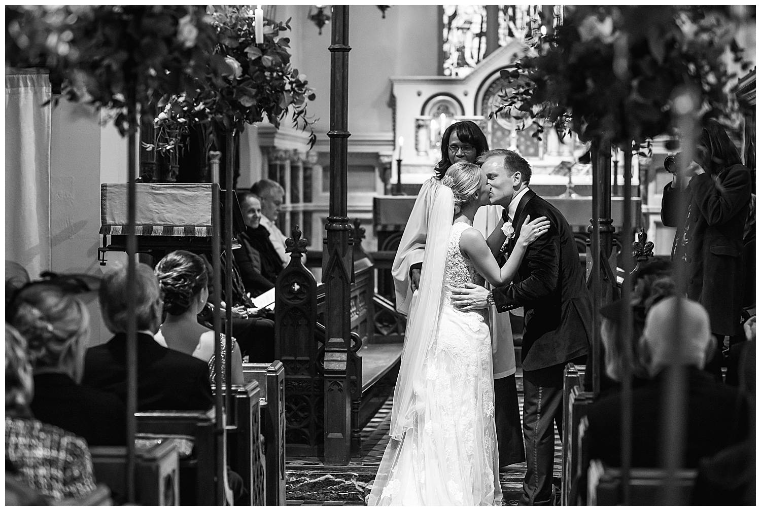 kiss at hedsor house church wedding