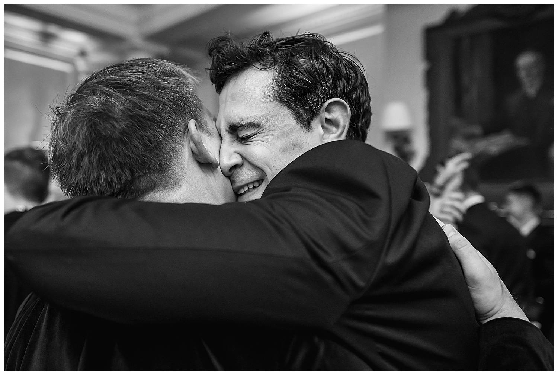 bestman hugs groom
