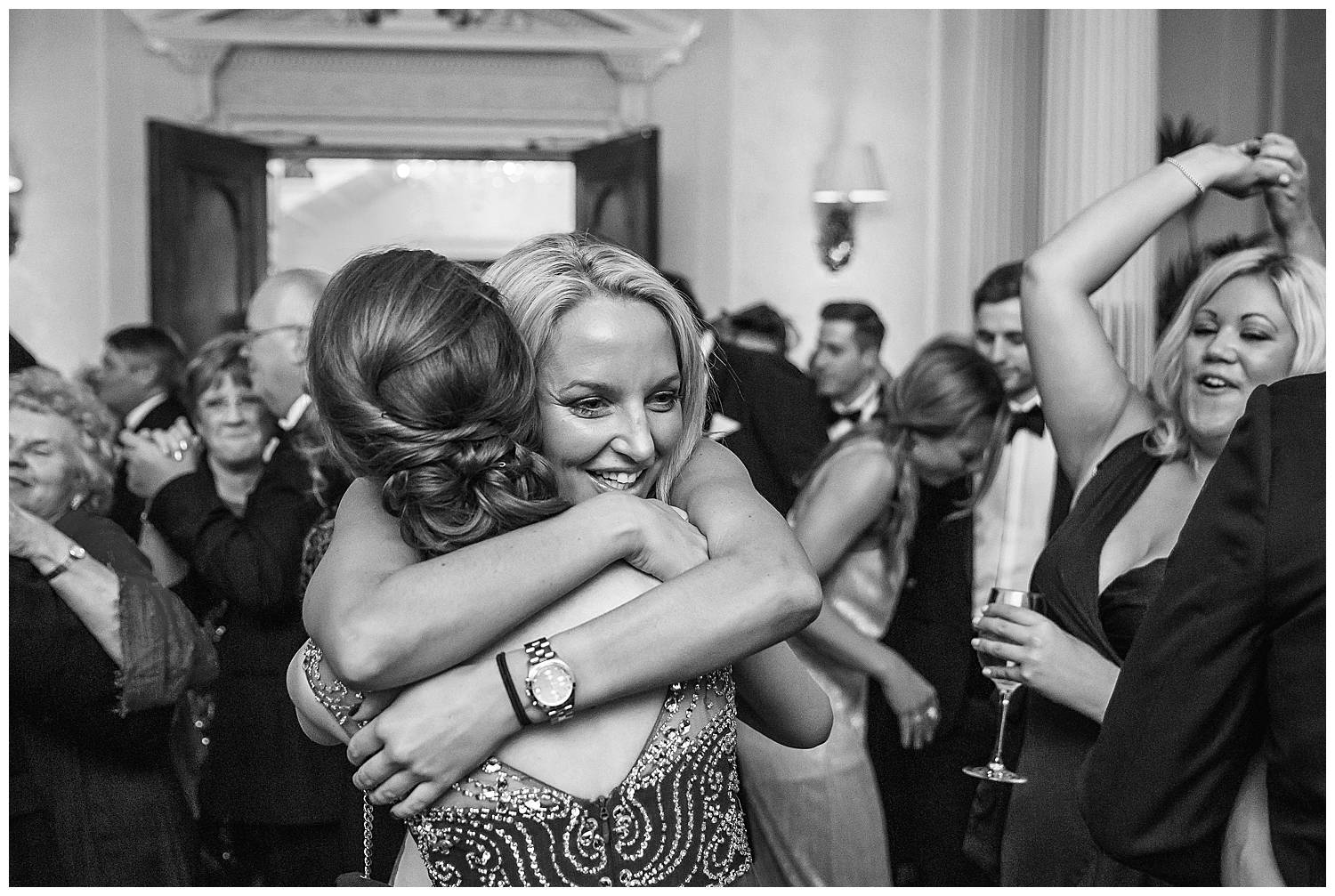 girl hugs bride
