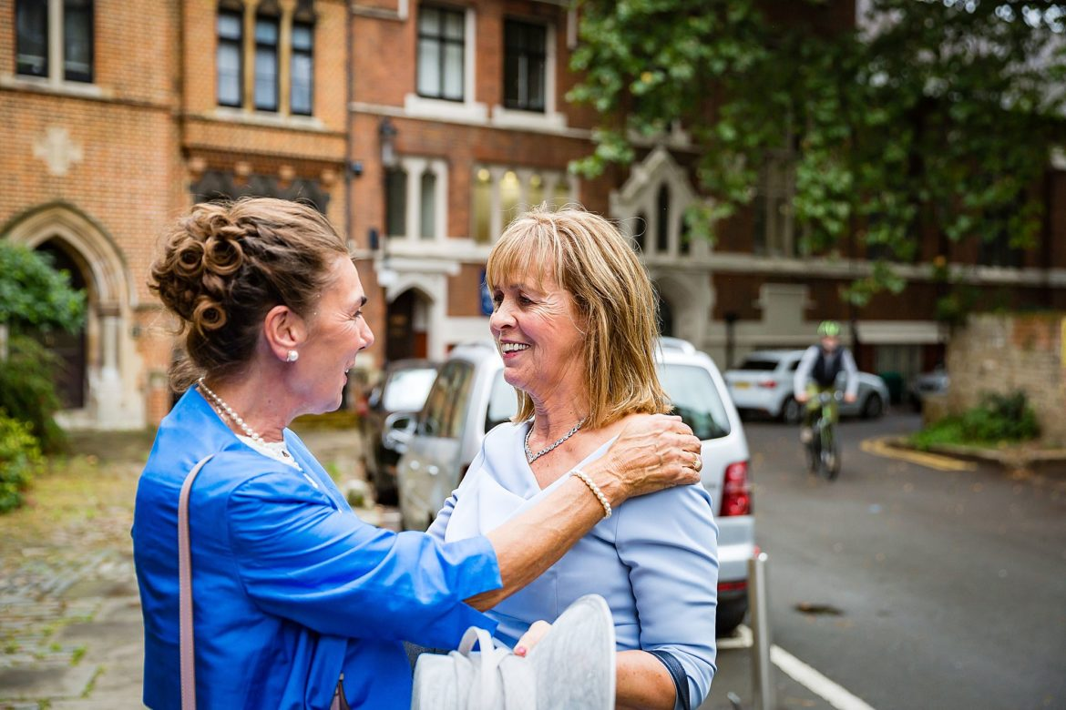 mums greet each other at Kensington Wedding