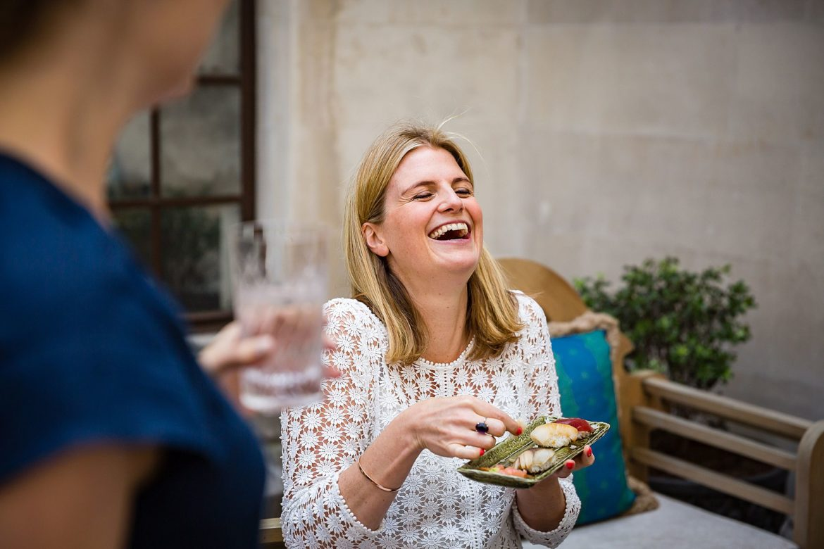 girls laugh while having lunch