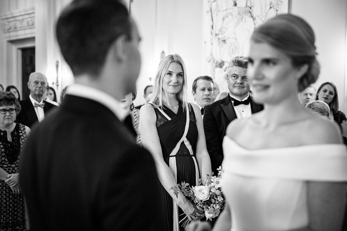 guests look at wedding