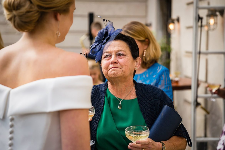 grooms mum looks at bride