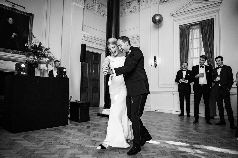 guests watch bride and groom dance