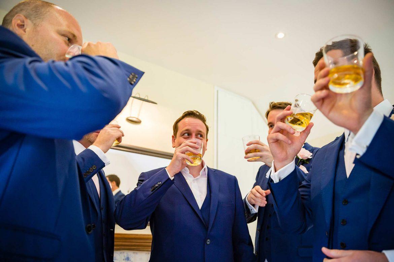 groom drinks whisky