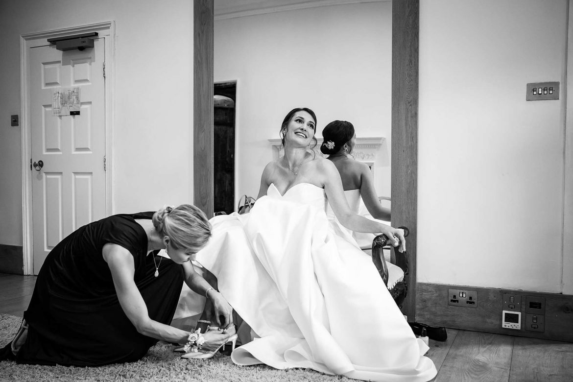 sister puts on brides shoes