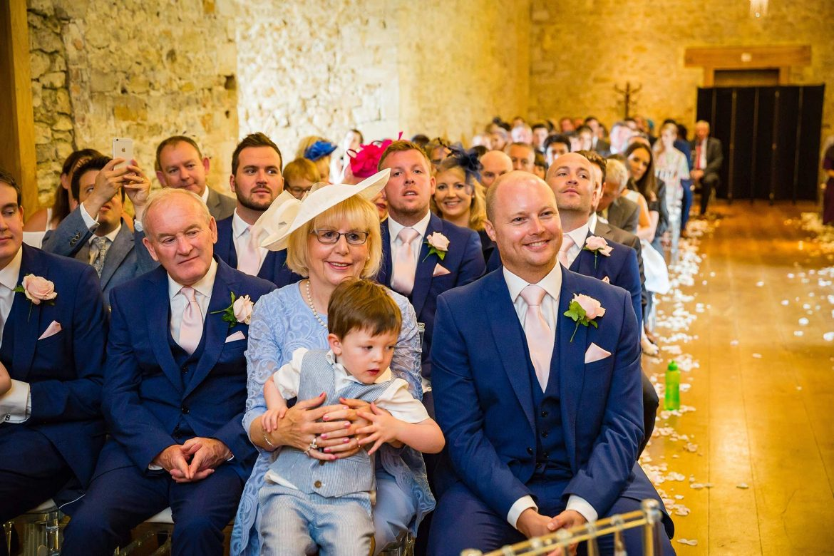 parents look at the ceremony at Notley Abbey