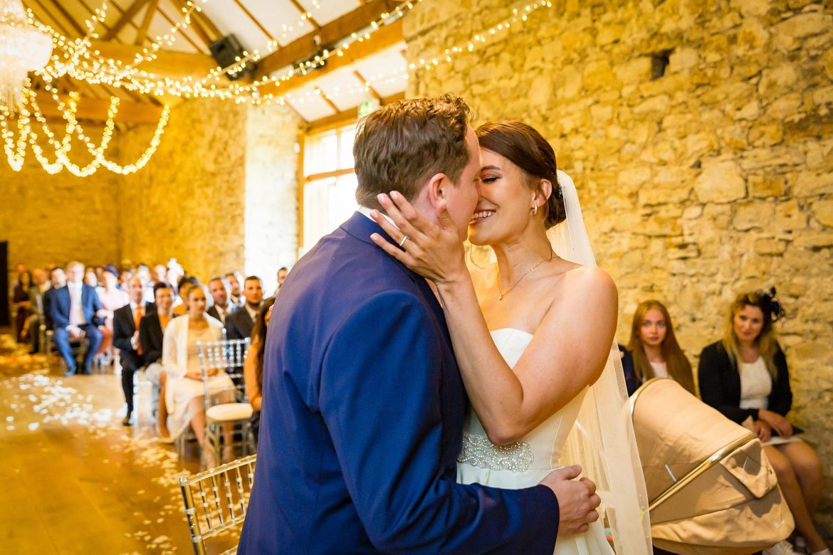 bride and groom kiss at the end of their Notley Abbey Wedding