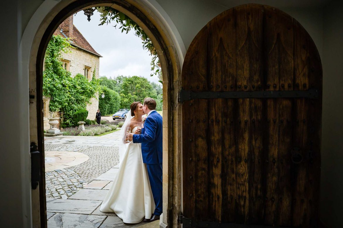 bride and groom kiss after their Notley Abbey Wedding