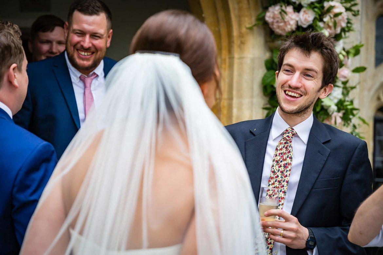 guests greet bride