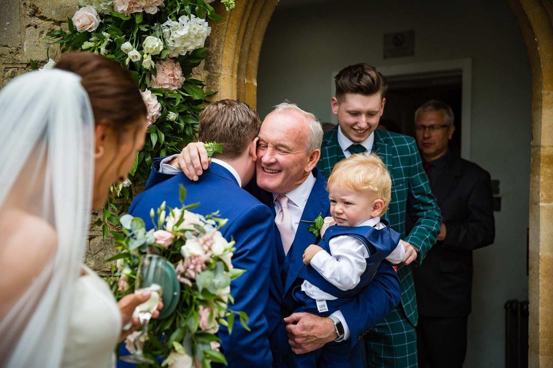 Dad hugs groom