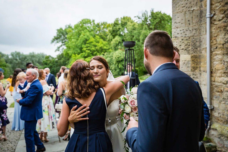 bride hugs family member