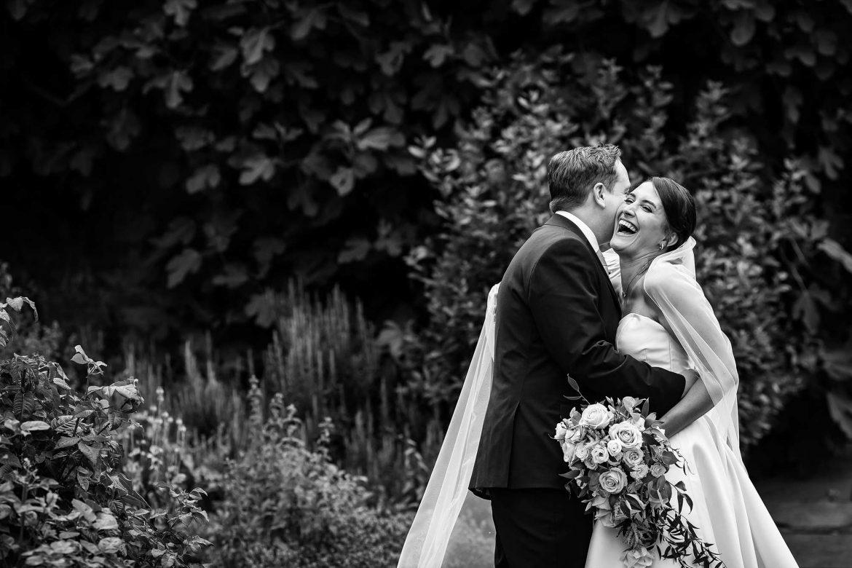 groom whispers in brides ear