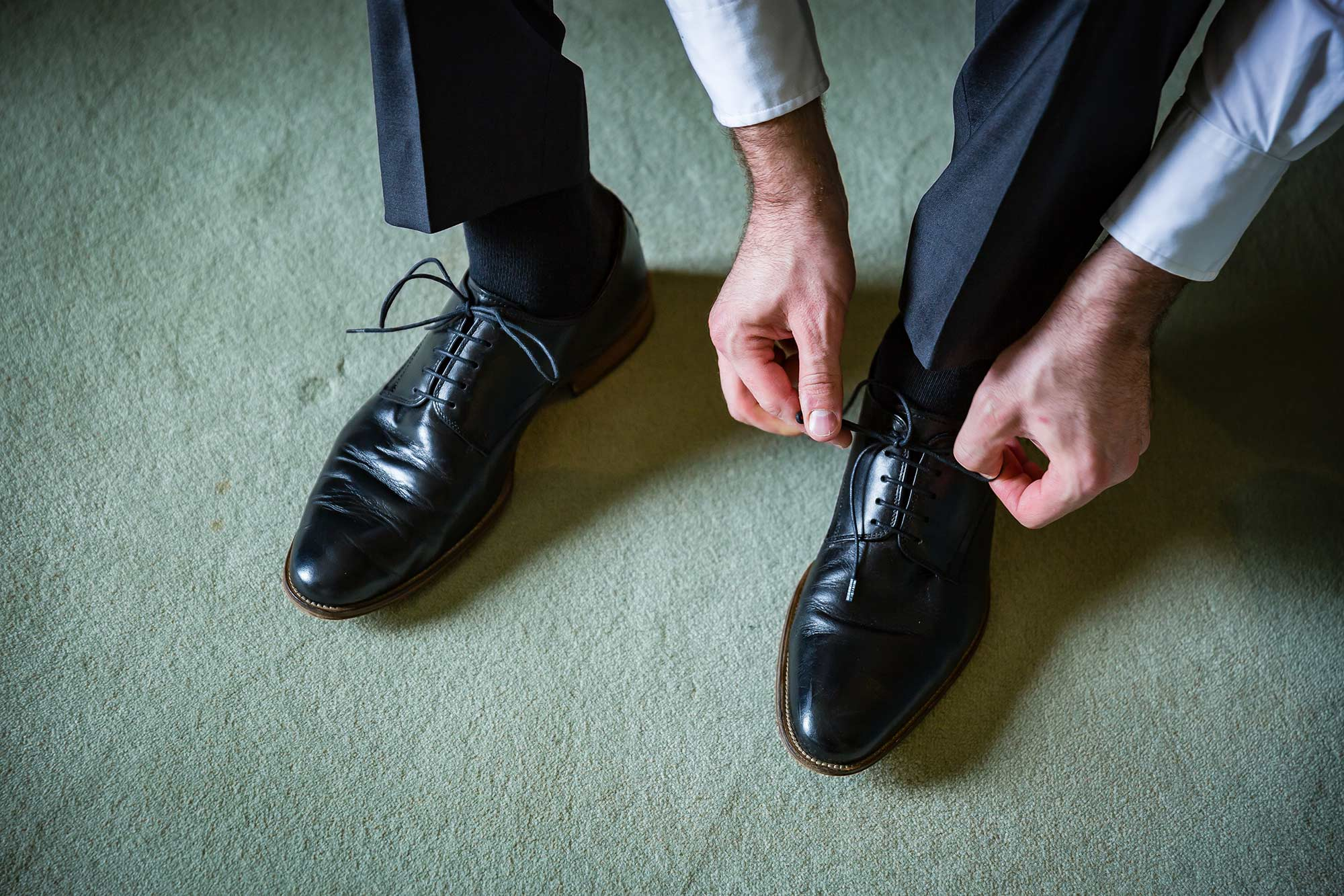 putting on wedding shoes