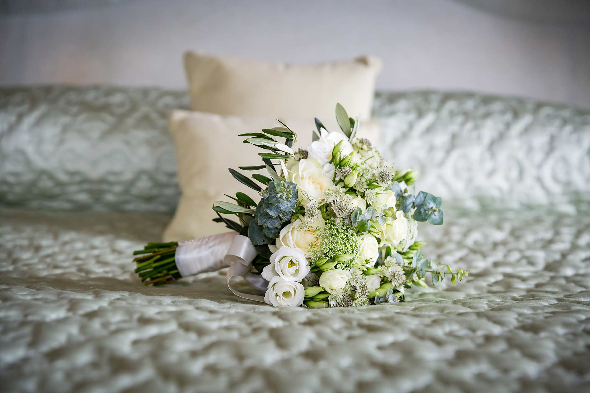 brides cream and green bouquet