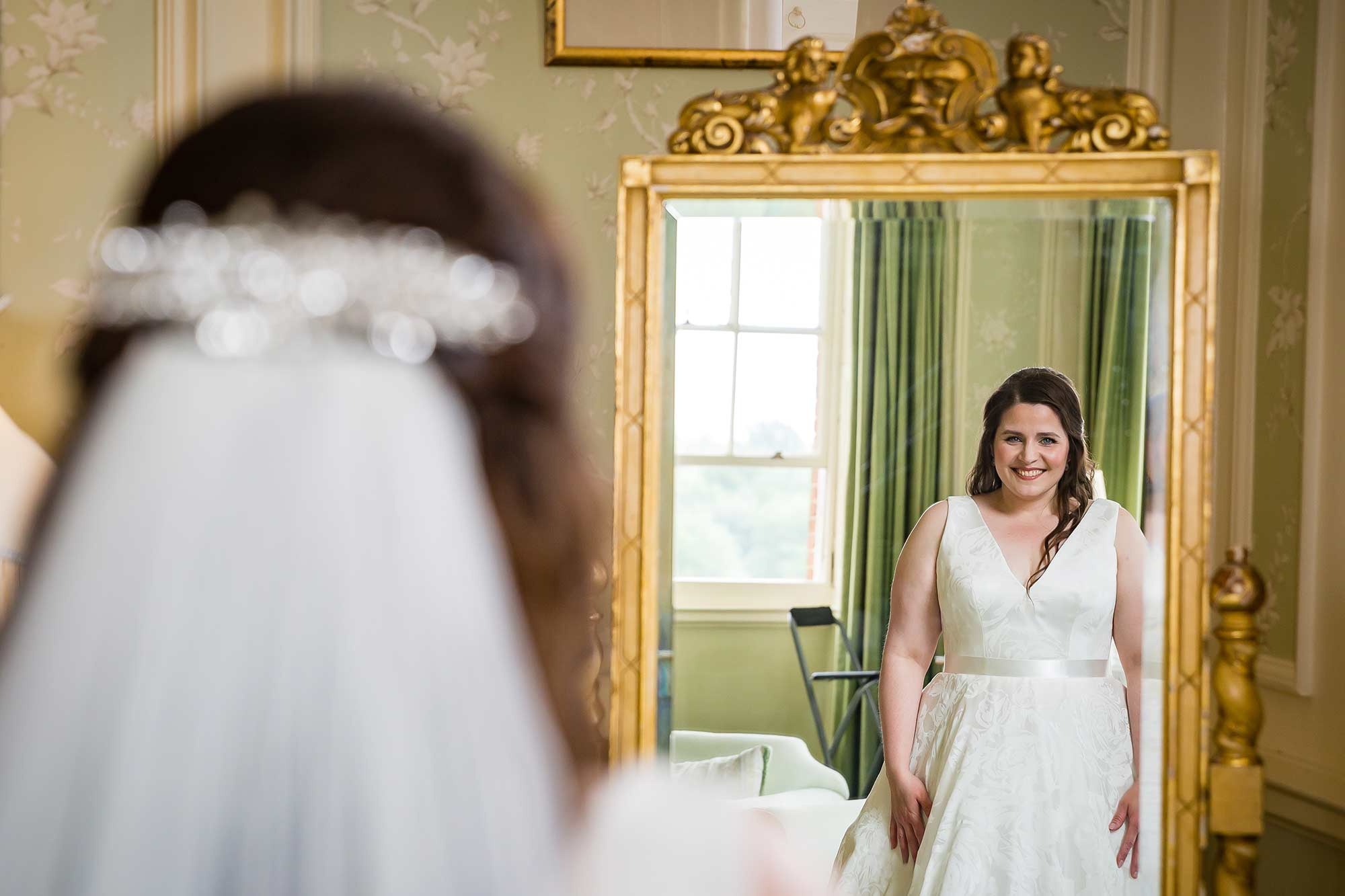 bride looks into mirror