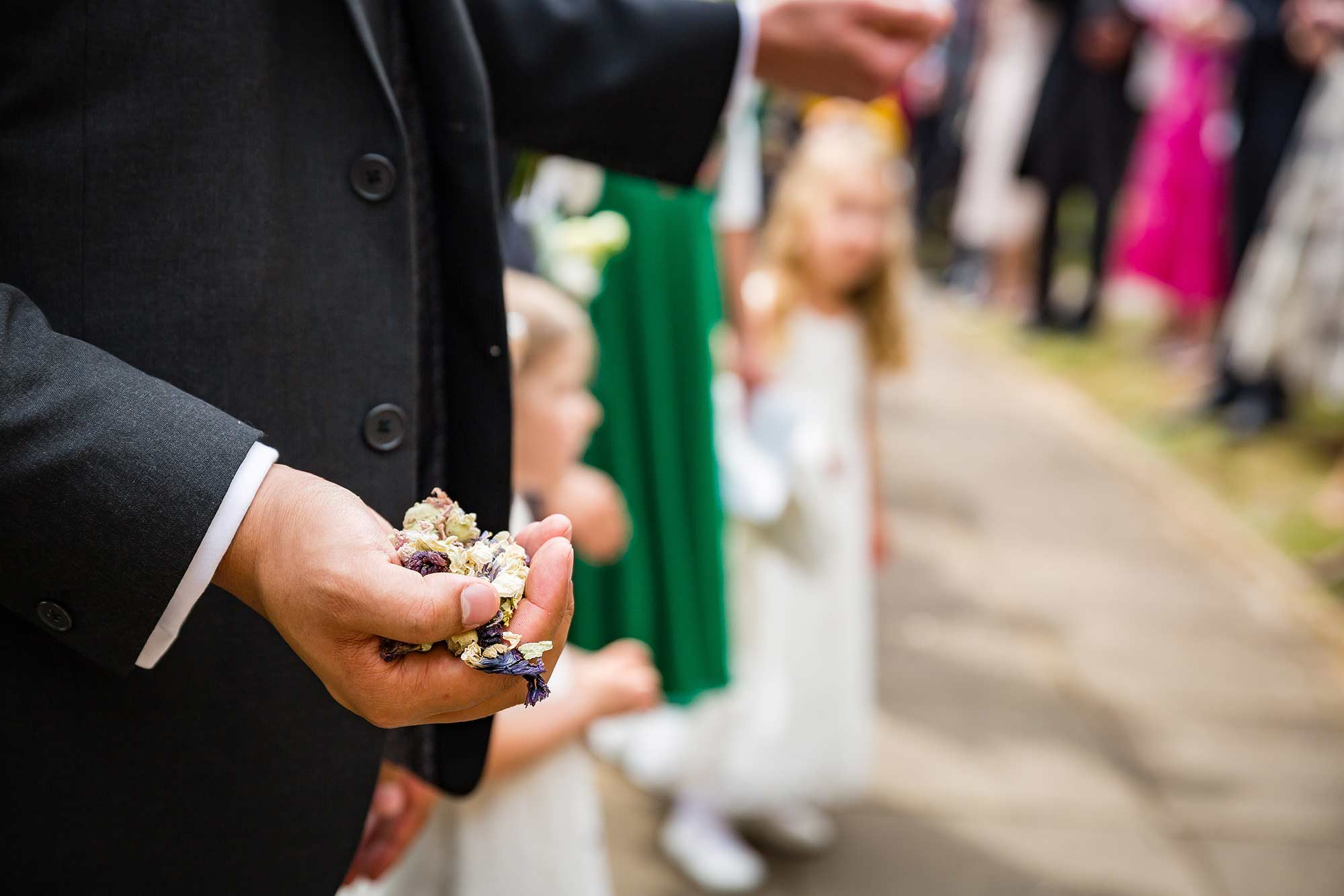 a hand holding confetti