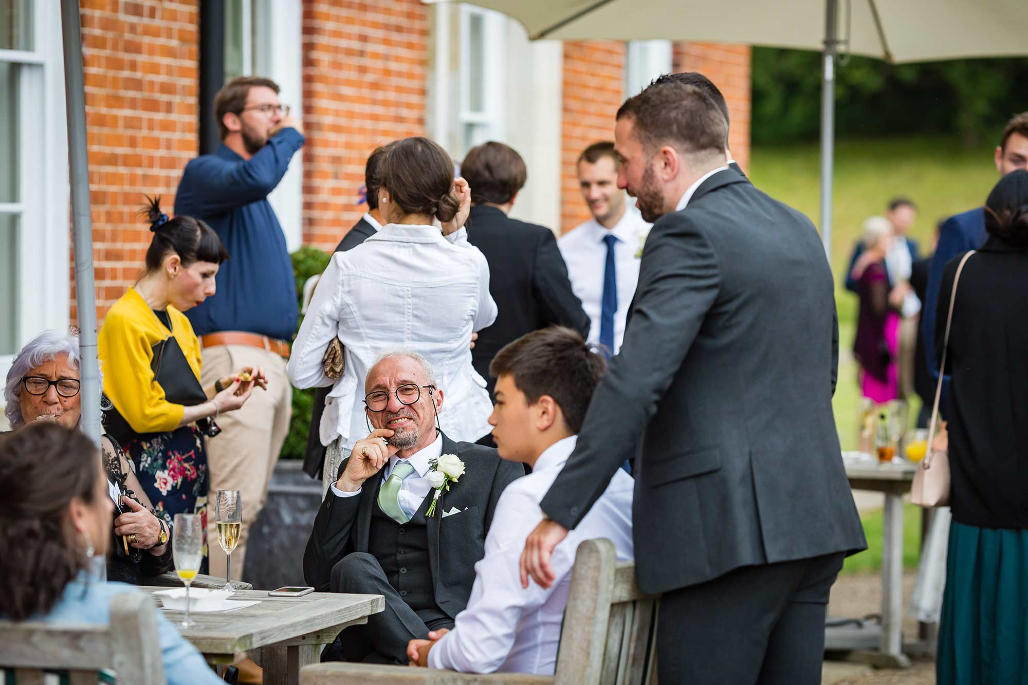 Grooms Dad chatting to his family