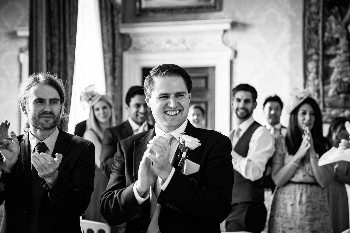 brother claps bride and groom