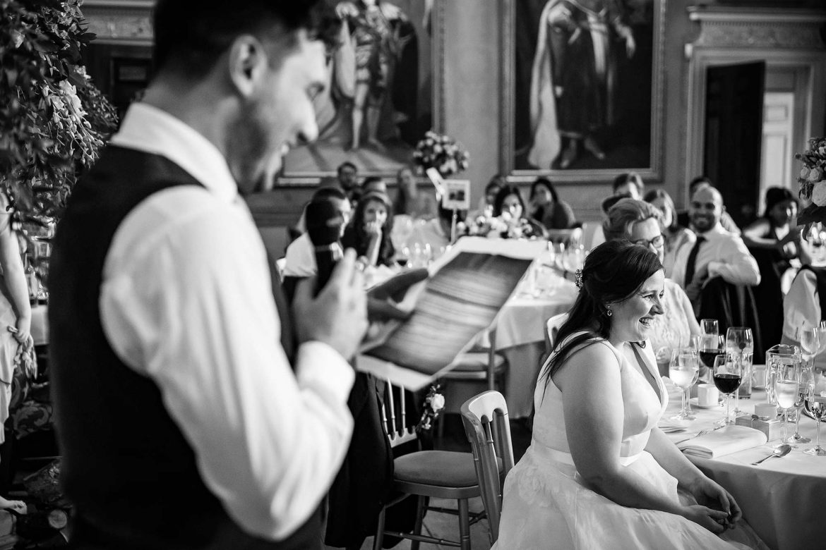 bride laughs at grooms speech