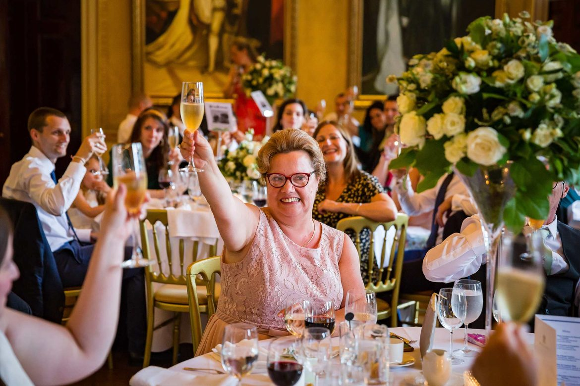 mother of the groom raises a glass
