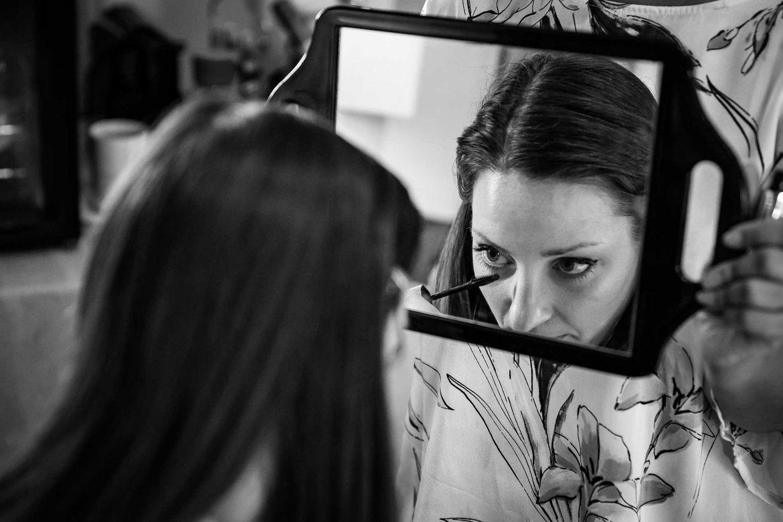 bride applies mascara