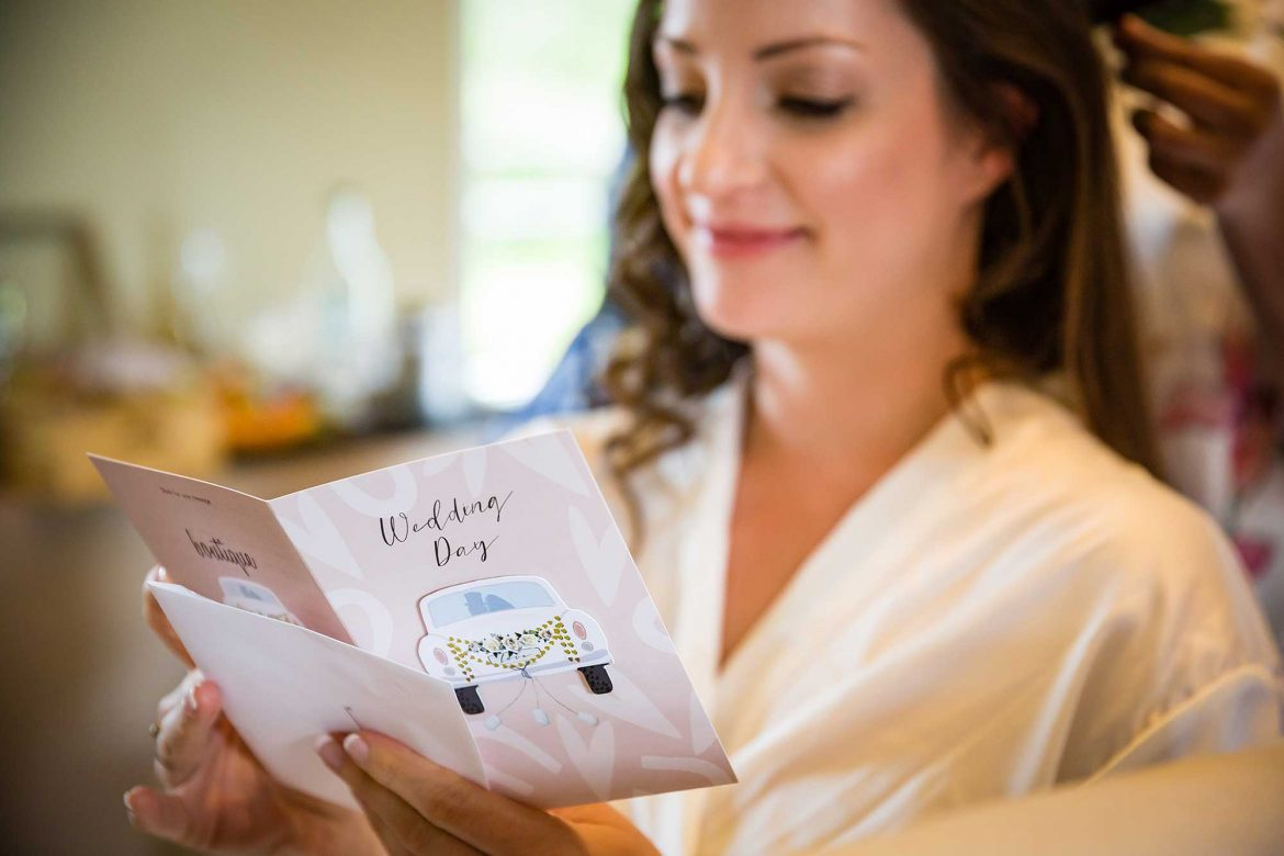 bride reads wedding card
