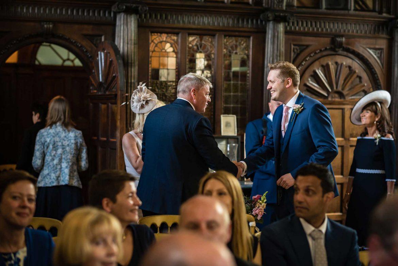 groom greets guests