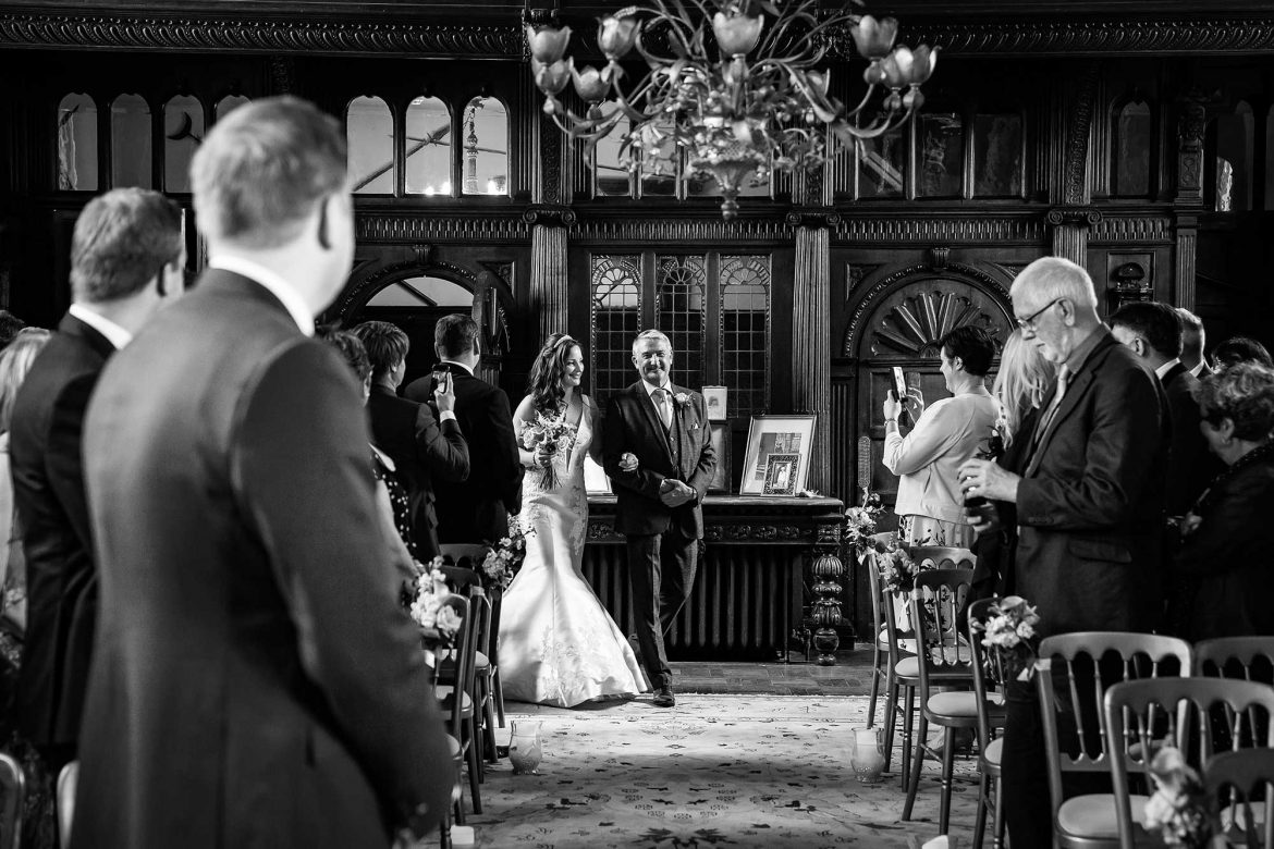 bride walks down the aisle at Loseley Park
