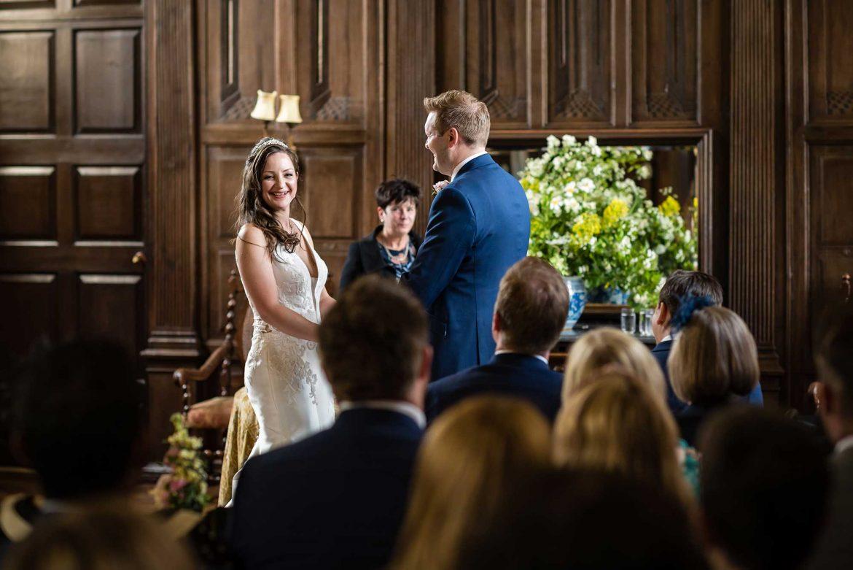 bride laughs in the wedding ceremony